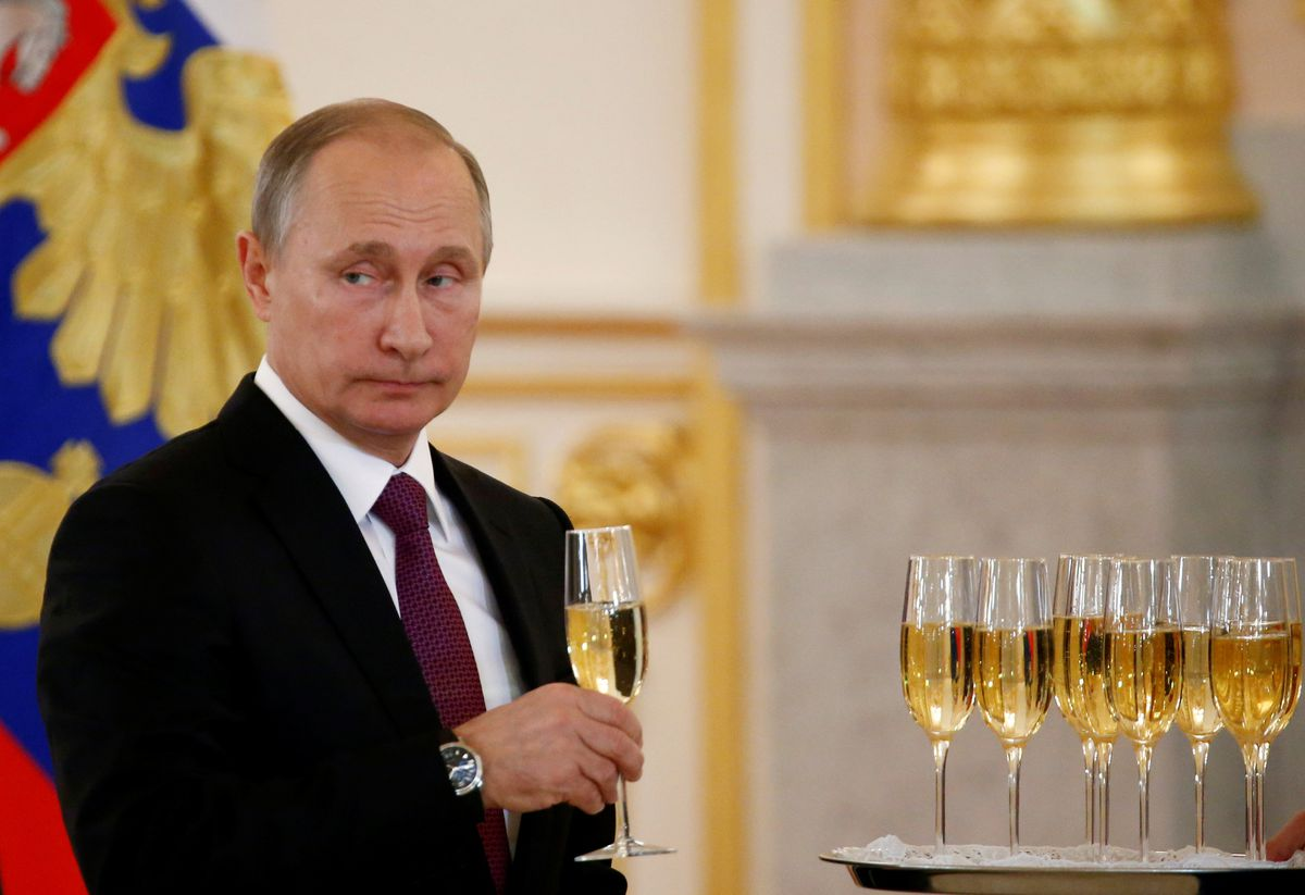 Russia's President Vladimir Putin holds a glass during a ceremony of receiving diplomatic credentials from foreign ambassadors at the Kremlin in Moscow, Russia, November 9, 2016. The Russian president was swift to congratulate Donald Trump on his victory in the presidential election. (REUTERS/Sergei Karpukhin)