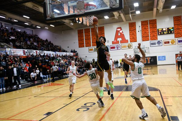 Trinity International's Daishen Nix, who is from Anchorage, lays the ball up in a game against Colony on January 23, 2020. (Marc Lester / Anchorage Daily News)