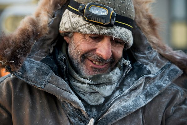 Nicolas Vanier, of Paris, France, smiles after reaching the finish line of the Iditarod in Nome on March 16, 2017. Vanier finished in 36th place. (Marc Lester / Alaska Dispatch News)