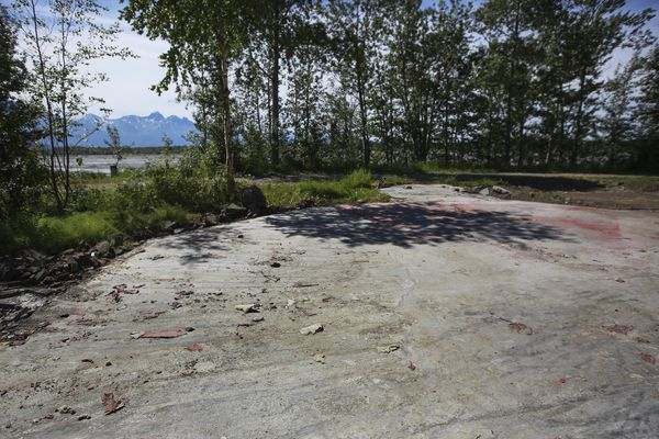 A cement platform is all that remains of a restaurant located on the edge of the Matanuska River, along N. Old Glenn Highway near Palmer, after its demolition, photographed on Thursday, July 1, 2021. (Emily Mesner / ADN)