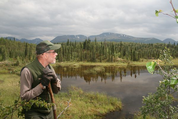 John Branson at a beaver pond in 2013. (Margaret Goodro / NPS)