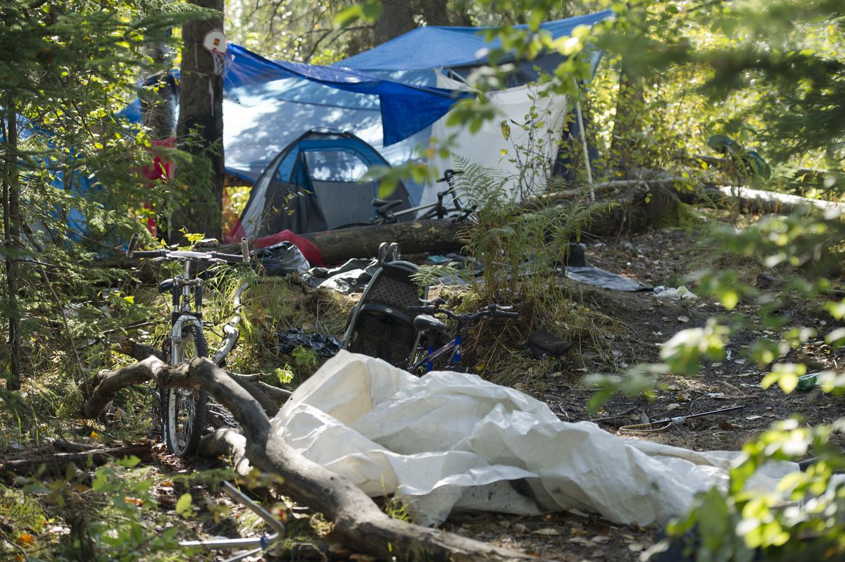 Anchorage Police say they've posted a notice that occupants must vacate a camp along the Chester Creek Trail west of Arctic Boulevard. (Marc Lester / Alaska Dispatch News)