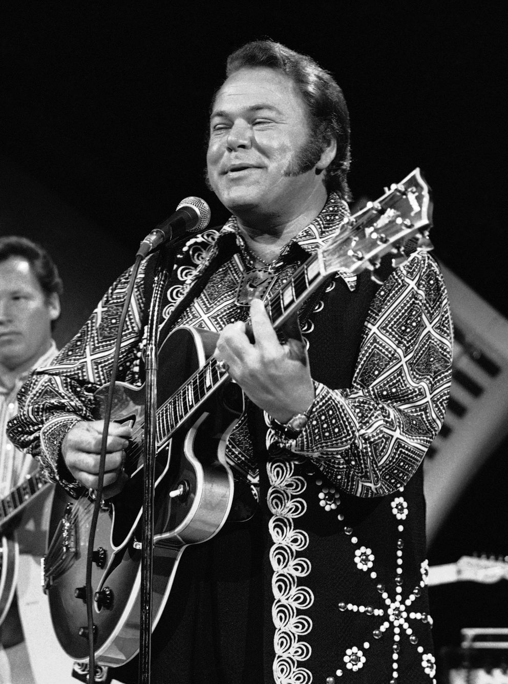 FILE - In this April 8, 1974, file photo, Roy Clark, one of the leading performers of country music on television, performs in Burbank, Calif. Clark, the guitar virtuoso and singer who headlined the cornpone TV show 'Hee Haw ' for nearly a quarter century, died Thursday, Nov. 15, 2018, due to complications from pneumonia at home in Tulsa, Okla., publicist Jeremy Westby said. He was 85. (AP Photo/Harold Filan, File)