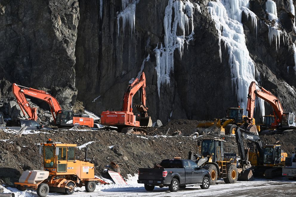 Heavy equipment is staged near rock mitigation site south of McHugh Creek along the Seward Highway on Tuesday. (Bill Roth / ADN)
