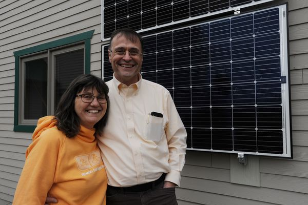 Dr. Brian Trimble and his wife Mary have solar panels on the garage of their Eagle River home and are in the process of getting approval to install a 5kw vertical wind turbine. Thursday, May 3, 2018. (Bill Roth / ADN)
