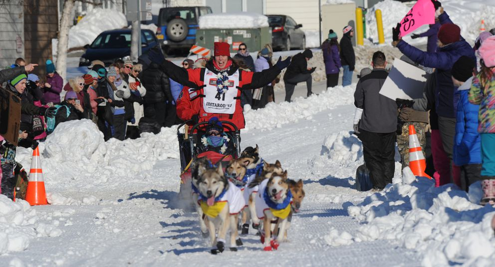 Aliy Zirkle acknowledges cheers as she winds through parties situated along the course at 16th Avenue during the Iditarod Trail Sled Dog Race ceremonial start in 2017. (Erik Hill / ADN)