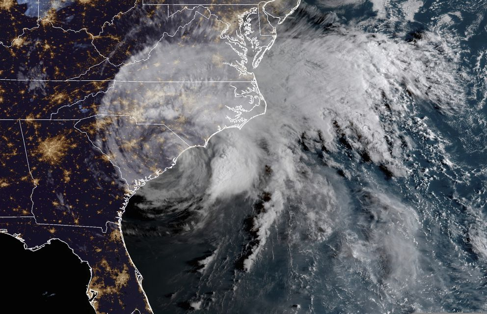 This satellite image provided by NOAA shows Hurricane Florence on the eastern coast of the United States early Saturday, Sept. 15, 2018. (NOAA via AP)