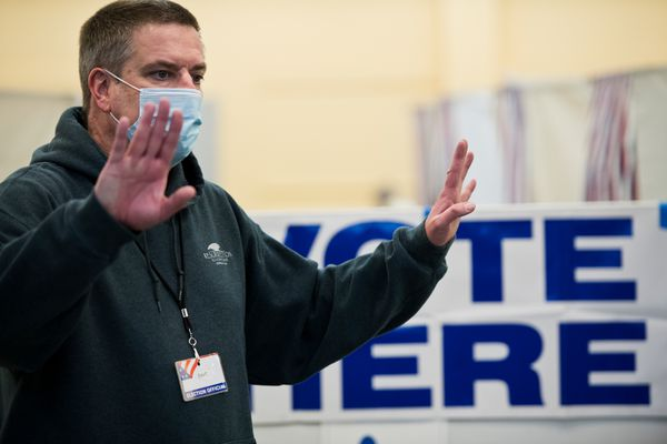 Bart Parker , a Division of Elections temporary worker, answers questions at the early voting location at the Midtown Mall on October 27, 2020. (Marc Lester / ADN)