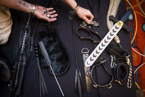 Bondage accessories at a talk by erotic romance author Eden Bradley during a conference in Anaheim, Calif., July 26, 2012. The line between bondage, dominance, sadism and masochism (BDSM) and abuse has been a topic of conversation after politicians were accused of abusing their sexual partners. (Leah Nash/The New York Times file)