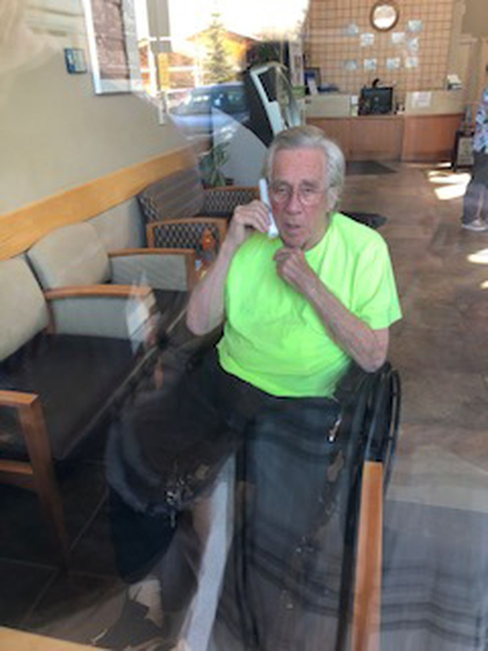 George Smith during a visit with his family through the window at Providence Transitional Care Center. Smith, 81, died Thursday, June 11, 2020, and he is the 12th Alaskan with COVID-19 to die since the start of the coronavirus pandemic. (Courtesy Susan Peck)