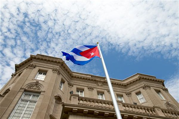 The Cuban flag is raised over its new embassy in Washington on Monday.