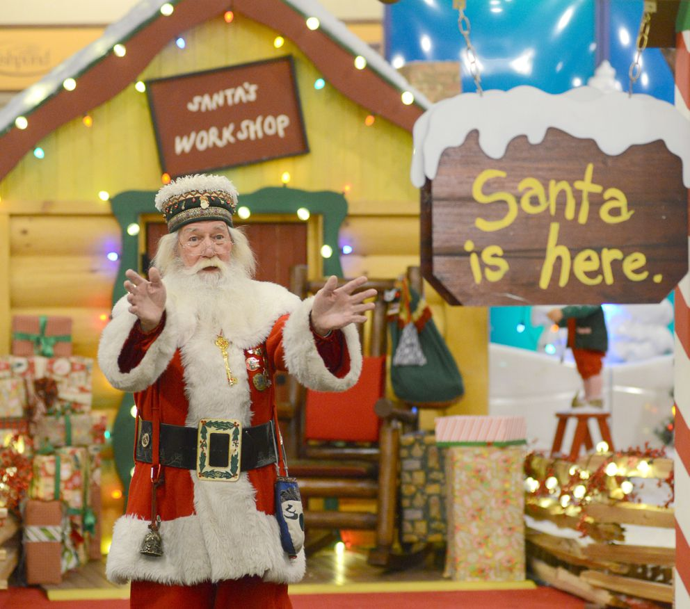 Santa Paul waves and welcomes children to talk to him on Christmas Eve. (Anne Raup / ADN)