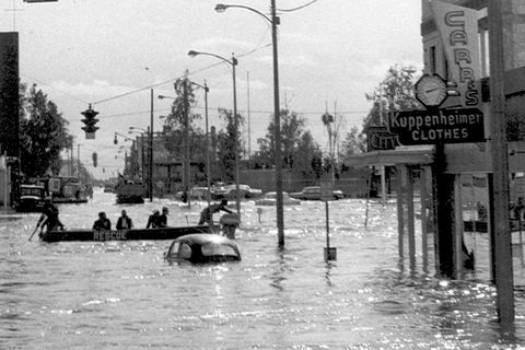 Cushman Street turned into a waterway during the 1967 flood, with people traveling by canoe and motorboat in waters that were three or four feet deep. (Fairbanks Daily News-Miner Collection)