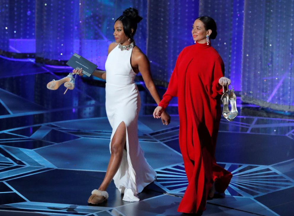 Tiffany Haddish (L) and Maya Rudolph take the stage to present the Oscar for Best Documentary Short Subject. REUTERS/Lucas Jackson