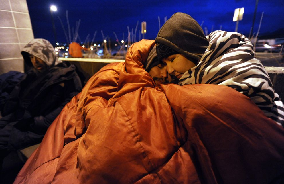 Allen Leavitt, who has been on the streets for eightyears, and Olga Tinker a 1-year vet of thestreets, wait outside the Brother Francis Shelter for a warm place to stay and escapenear-zero temperatures on Wednesday, Nov. 30, 2016. (Bill Roth / Alaska Dispatch News)