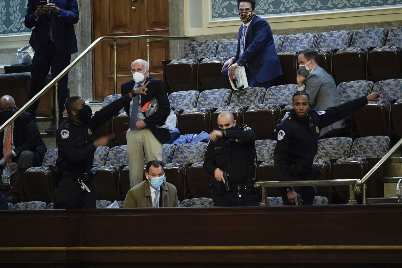 Lawmakers prepare to evacuate the House gallery as protesters try to break into the House Chamber at the U.S. Capitol on Wednesday, Jan. 6, 2021, in Washington. (AP Photo/J. Scott Applewhite)