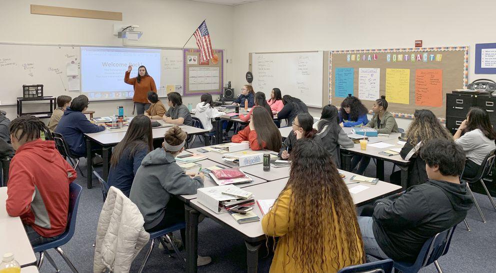 Jordan Jensen, a language arts teacher at East High School, talks to her students about the Nov. 30 earthquake on Monday. (Tegan Hanlon / ADN)