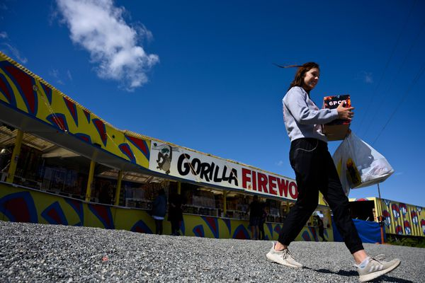 Karlie Anderson carries her purchases away from Gorilla Fireworks in Houston on June 30, 2020. (Marc Lester / ADN)