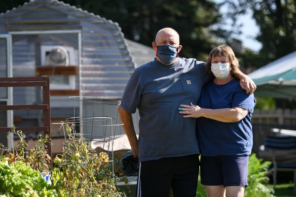 Frank Philip, standing with his wife Heather, said more people would be wearing masks if they had gone through what he had experienced with COVID-19. (Marc Lester / ADN)