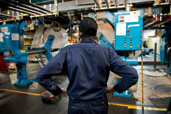 Mike Green tends to the paper rolls. Pressmen, inserters and other staff produced the print edition of the Alaska Dispatch News for the last time at the press facility on Northway Drive late Oct. 14 and early Oct. 15, 2017. The press had been the production center for the Anchorage Daily News, and in recent years Alaska Dispatch News, since the 1980s. (Marc Lester / Alaska Dispatch News)
