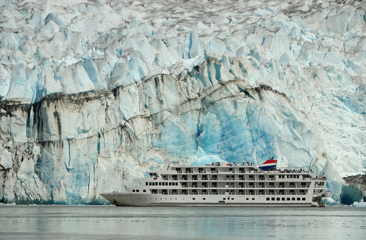 The cruise ship American Constellation passes in front of Sawyer Glacier in the Tongass National Forest in Southeast Alaska on Friday, July 20, 2018. (Bob Hallinen / ADN)