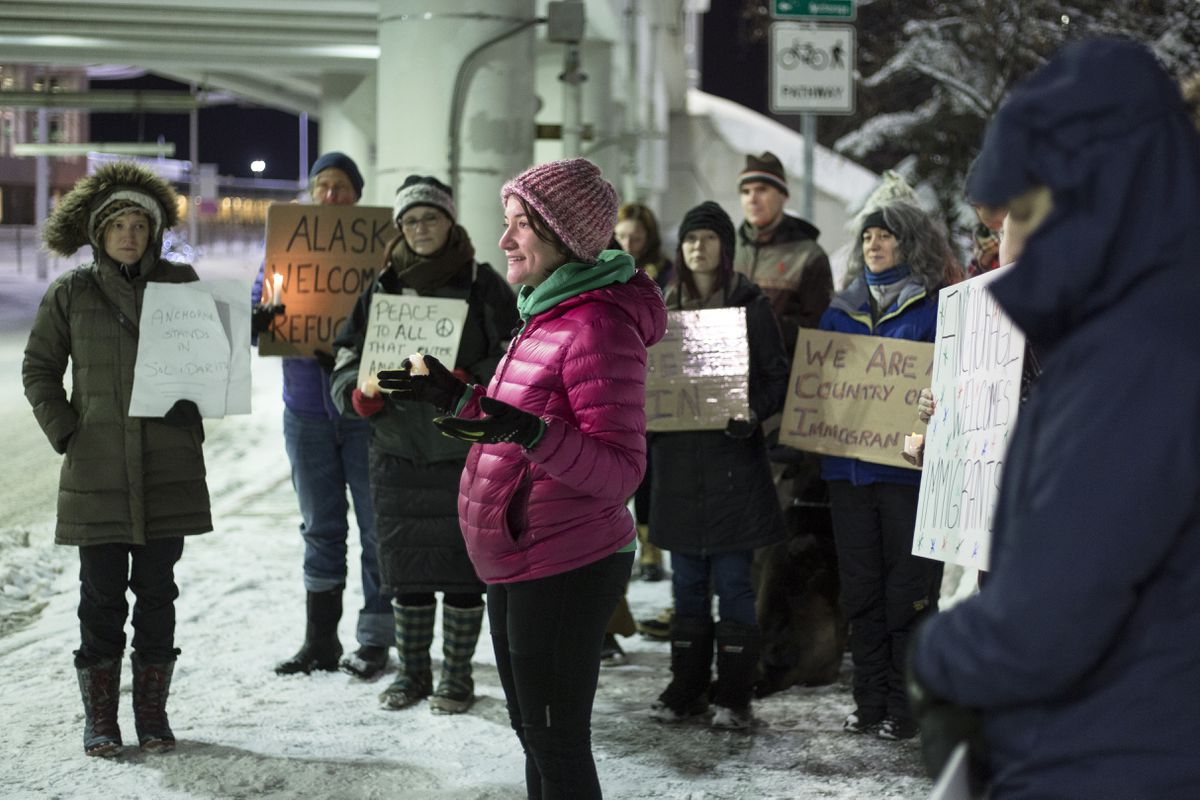 Elana Habib speaks to demonstrators gathering to show support and acceptance for incoming refugees on Saturday at Ted Stevens Anchorage International Airport. (Rugile Kaladyte / Alaska Dispatch News)