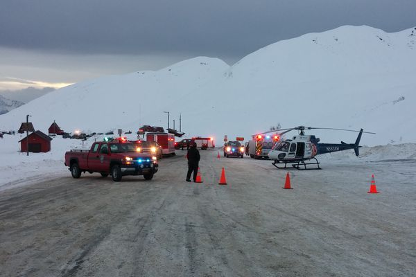 Emergency vehicles are gathered in the parking lot near Summit Lake in Hatcher Pass after an avalanche on Saturday, Jan. 16, 2016.