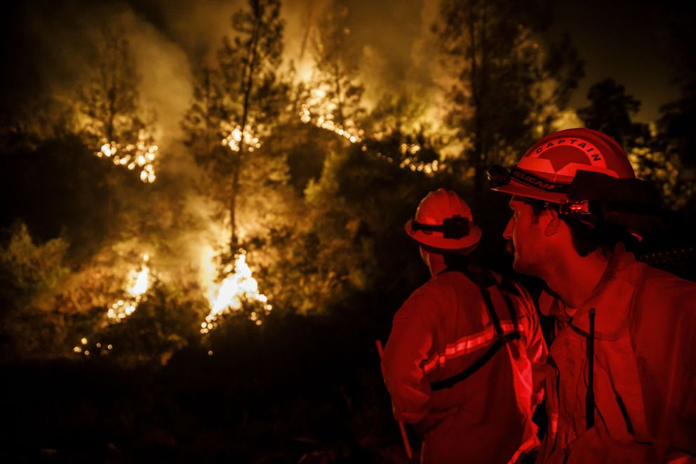 Firefighters monitor a burn operation near the town of Ladoga, Calif., on August 7, 2018. (Marcus Yam/Los Angeles Times/TNS)