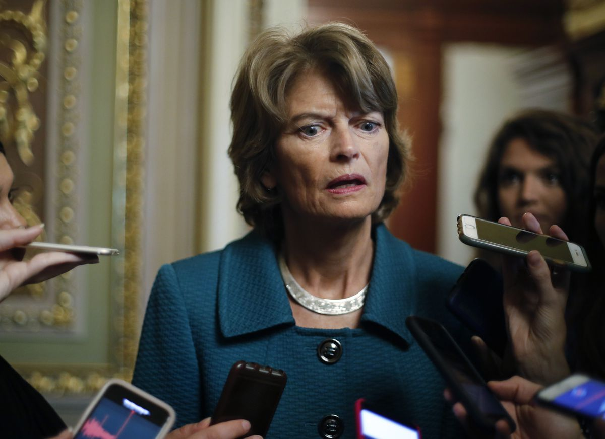 Sen. Lisa Murkowski, R-Alaska, speaks to members of the media after a vote to advance Brett Kavanaugh's nomination to the Supreme Court, on Capitol Hill, Friday, Oct. 4, 2018. (AP Photo/Pablo Martinez Monsivais)