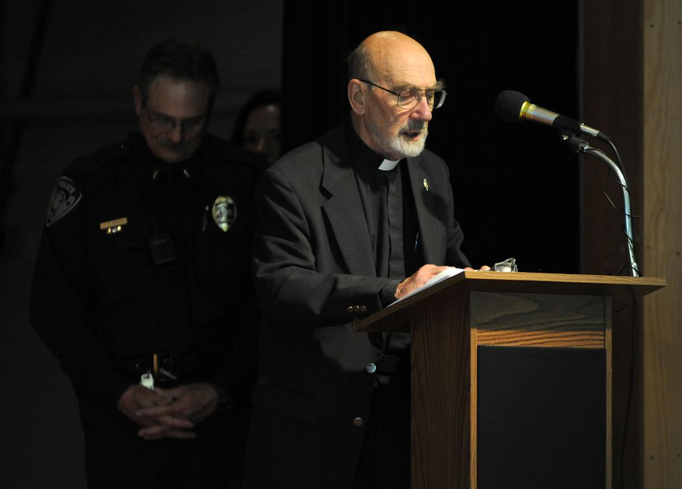 The Rev. Norman Elliott delivers the invocation at a ceremony honoring 50 heroes for their efforts to rescue victims from a June 1, 2010 plane crash in Fairview Thursday evening September 9, 2010 at Central Middle School. (Erik Hill / ADN archive)