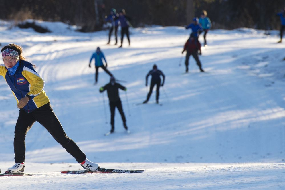 Grace Miller trains with the Palmer High School cross country ski team at the Government Peak Recreation Area trails on Feb. 1, 2018. Miller said she had always been the only racer who competed with one hand and one pole until she got involved with the Paralympic organization. (Marc Lester / ADN)