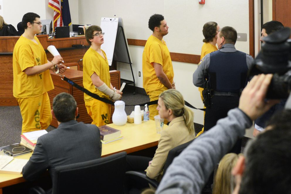 Bradley Renfro, second from left, speaks as he leaves his arraignment hearing in the David Grunwald murder case on Tuesday, Dec. 13, 2016, at Palmer Superior Court. Grunwald's parents, Ben and Edie Grunwald, were sitting in front of Renfro's parents and believed the teenager was addressing them, while Renfro's parents said he was addressing his father. Dominic Johnson followed Renfro at left, as Devin Peterson walked in from of him trailing Austin Barrett. (Erik Hill / Alaska Dispatch News) (Erik Hill / Alaska Dispatch News)