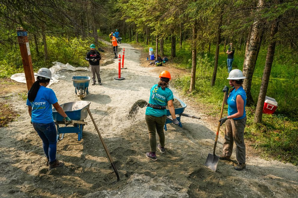 A Youth Employment in Parks crew works on improving a section of the Tour of Anchorage trail on Wednesday. (Loren Holmes / ADN)