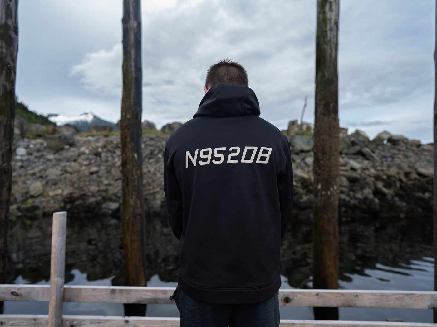 Randy Sullivan's son, Spencer, wears a hoodie with the tail number of his late father's plane printed on the back. (Ash Adams for ProPublica)