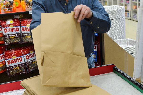 Ron Petersen, of Red Apple Markets, said they've stocked paper bags, which will be available for $.10 each once the plastic bag ban goes into effect. (Marc Lester / ADN)
