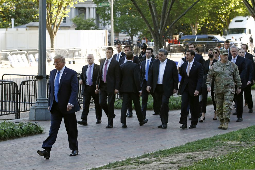 President Donald Trump walks in Lafayette Park to visit outside St. John's Church across from the White House Monday, June 1, 2020, in Washington. Part of the church was set on fire during protests on Sunday night. (AP Photo/Patrick Semansky)