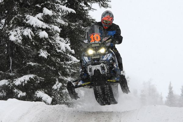 Two-time Iron Dog champion Chris Olds gets some air during the pro class restart at Big Lake on Sunday, Feb. 19, 2017. (Bill Roth / Alaska Dispatch News)