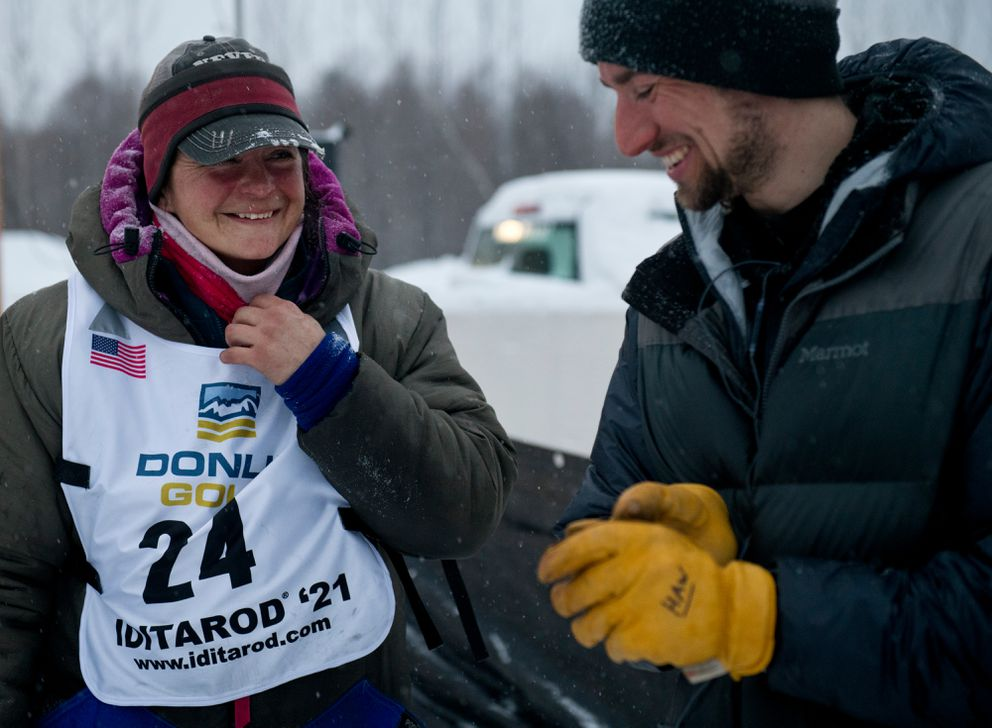 Jessie Royer talks with fellow veteran musher Jeff Deeter at Deshka Landing after they both finished Iditarod on March 15, 2021. (Marc Lester / ADN)