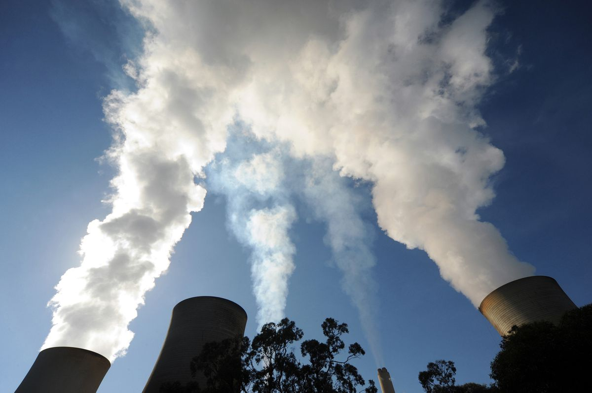 Steam billows from the cooling towers of the Yallourn coal-fired power station in the Latrobe Valley, Australia, on Wednesday, April 29, 2015. (Bloomberg photo by Carla Gottgens)