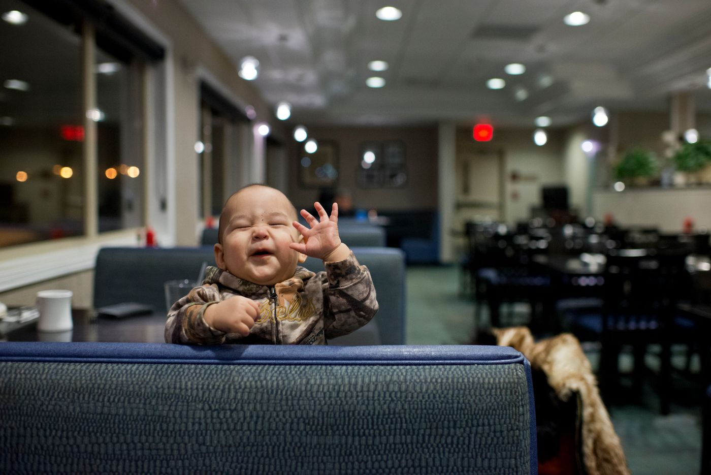 Nine-month-old Dillon Patkotak plays with his mom, Flora Patkotak, while the family dines at Niggivikput, a restaurant in the Top of the World Hotel. (Marc Lester / Alaska Dispatch News)