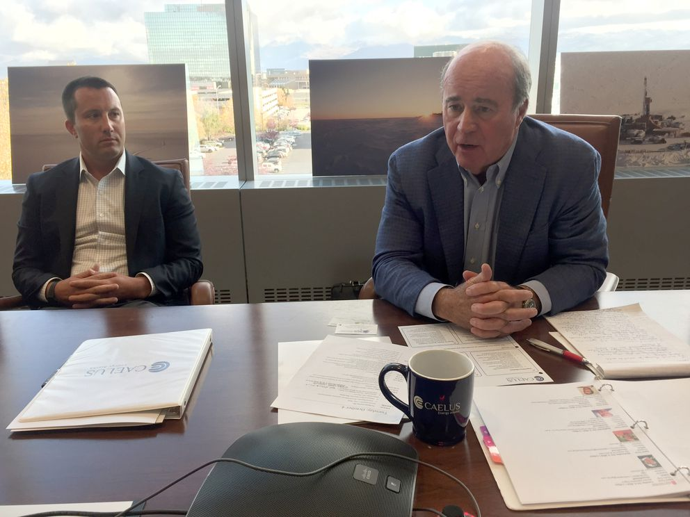 Jim Musselman and his son Matt talk in the Caelus Energy Alaska offices Tuesday. Jim is the CEO and Matt is senior vice president. (Alex DeMarban / Alaska Dispatch News)