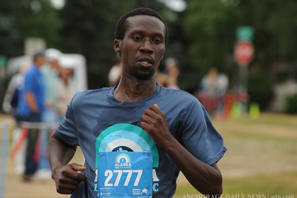 Micah Chelimo finishes the Skinny Raven 10-K Classic in first place on Saturday, August 3, 2013 at the Park Strip in Anchorage, AK.