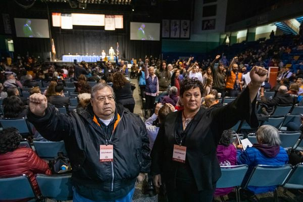 "Will Hanbury, Jr. of Sitka and Nicole Hallingstad, from Petersburg, stand in silent protest during an address by Alaska Governor Mike Dunleavy during the Alaska Federation of Natives convention Thursday, Oct. 17, 2019 at the Carlson Center in Fairbanks. ""I was standing for missing and murdered indigenous women,"