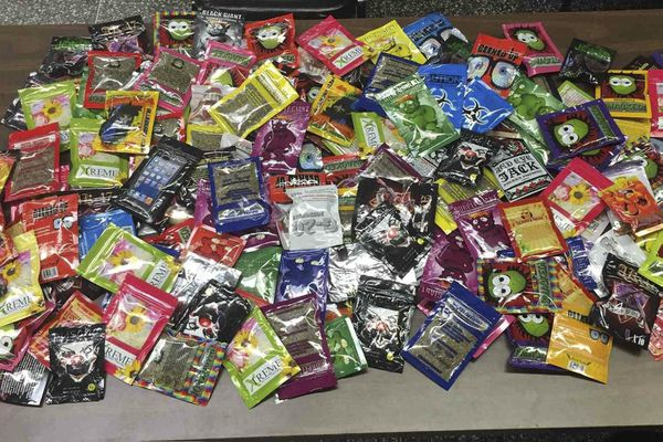 This photo provided Friday, Aug. 7, 2015, by the New York Police Department shows packets of synthetic marijuana seized after a search warrant was served at a newsstand in Brooklyn, N.Y.