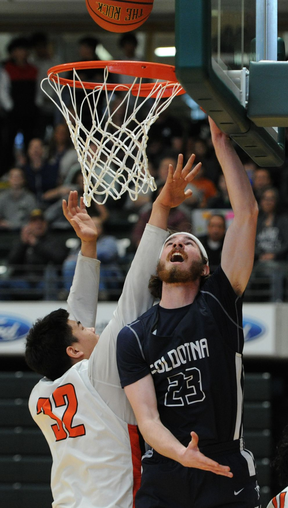 West High's Anthony Snow defends as Soldotna's David Michael puts up a shot during the Stars' 45-42 first-round victory. (Bill Roth / ADN)
