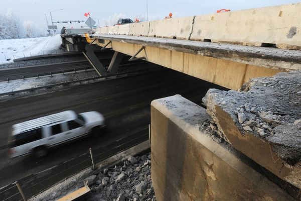 Northbound traffic on the Seward Highway flows past the Tudor Road overpass on Tuesday, Jan. 8, 2019, after the damaged girder was removed allowing the highway to be reopened. (Bill Roth / ADN)