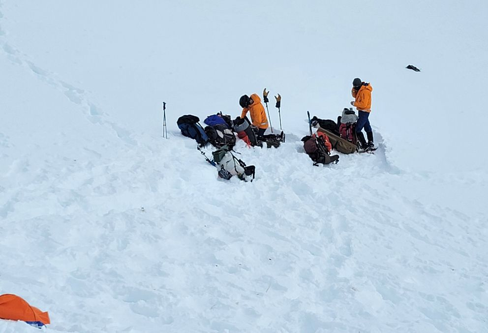 Volunteers with the Alaska Mountain Rescue Group are on the scene of the helicopter crash in the Chugach Mountains near the Knik Glacier, Sunday, March 29, 2021. (Alaska Mountain Rescue Group photo via Alaska State Troopers)