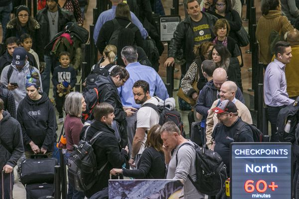 Air travelers endured waits of more than an hour to get through domestic checkpoints at Hartsfield-Jackson International Airport in Atlanta amid the partial federal shutdown Monday morning, Jan. 14, 2019. No-shows among screeners across the nation soared Sunday and again Monday, the first business day after TSA agents missed paychecks for the first time due to the partial government shutdown that began on Dec. 22. (John Spink/Atlanta Journal-Constitution via AP)