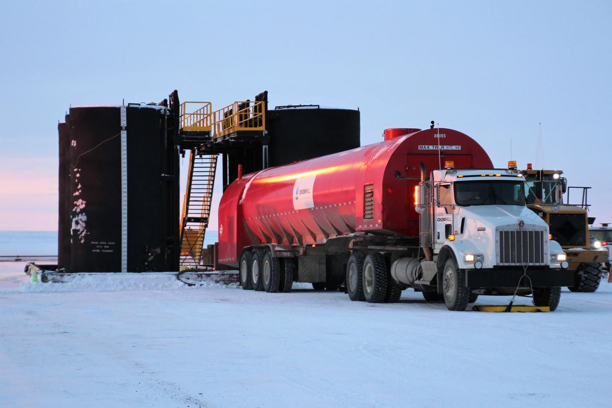 Crude oil is loaded in a tanker truck at the Mustang Operations Center near the Kuparuk River field on the North Slope. The road and gravel pad constructed with state money to facilitate oil production at the site has only been used by other companies for staging and other purposes since it was completed in 2013. (Photo courtesy Alaska Industrial Development and Export Authority)