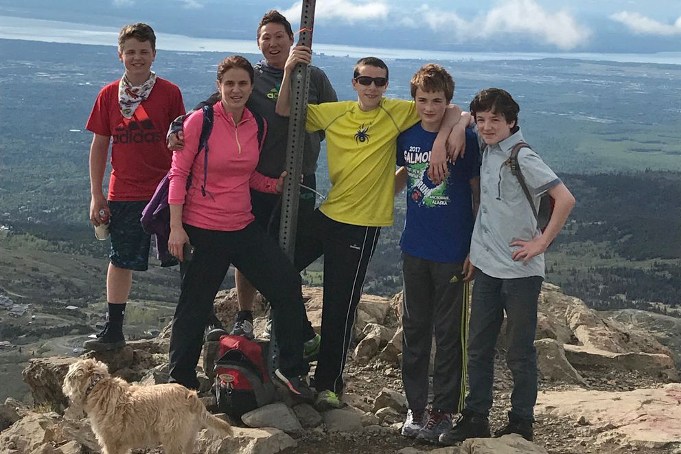 Jack Cooper (yellow shirt) is surrounded by family and friends on the top of Flattop. (Courtesy Katrina and Rose Garner)